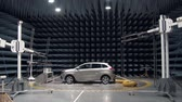 electromagnetic : new automobile is standing in anechoic chamber for testing on a car plant, transmitters