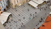 Čechy : tourists are strolling in old town of Prague in daytime, top view from Old Town Hall Dostupné videozáznamy