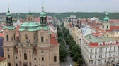 praga : top view of Church of Saint Nicholas and picturesque street in Prague from Old clock tower