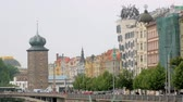 čeština : panorama of facades of old historical buildings in Prague in summer in cloudy weather