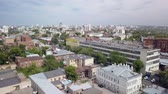 suburbano : aerial moving panorama of big city in sunny summer day, camera flies