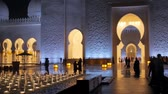 ABU DHABI, U.A.E. - JAN, 2018: Sheikh Zayed Grand Mosque in night time, panoramic view of main entrance