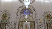 swarovski : ABU DHABI, U.A.E. - JAN, 2018: Sheikh Zayed Grand Mosque, inner view, panorama from people to ceiling