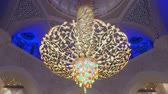 swarovski : ABU DHABI, U.A.E. - JAN, 2018: Sheikh Zayed Grand Mosque, interior, tilt up view on crystal chandelier Stock Footage