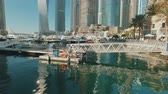 water of sea in yacht mooring pier in Dubai Marina and skyscrapers in sunny day