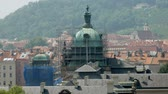 red roofs tops and dome of ancient church under reconstruction in sunny day Stok Video