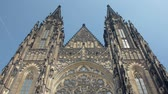 frontal tilt up view of facade of ancient gothic church St Vitus cathedral in Prague Стоковые видеозаписи