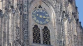 old clock on tower of medieval castle in sunny day, close-up view Стоковые видеозаписи