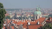 panoramic top view on Prague city with red roofs and domes of churches