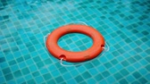 red : The lifebuoy floats in the pool
