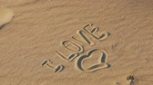 lua de mel : Inscription love on sanThe inscription on the sand I love, the symbol of love.d. Stock Footage
