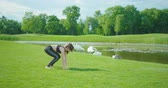 relaxation : The horizontal view of the slender woman doing pilates on the meadow.