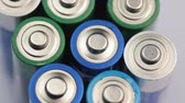 hazardous waste : Macro Video of the Batteries Top. Concept of Energy, Power and Recycling. Stock Footage