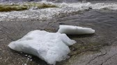 amper : Fast flow on the river. Foam is floating on the water. Power of nature.