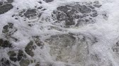 Fast flow on the river. Foam is floating on the water. Power of nature.