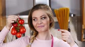 bolognese : Woman holding pasta and tomatoes