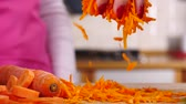 grate : Grated carrot falling from top Stock Footage