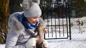 два человека : Woman playing with her little dogs outside winter