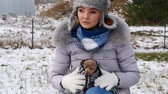 miniatűr : Worried woman taking care of small dog during winter