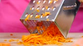 grate : Hand grating carrot Stock Footage