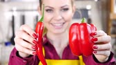 kararlar : Woman choosing between chilli and bell pepper
