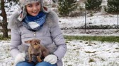 ушки : Woman playing with her little dog outside winter