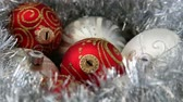 copy : Christass decorations white and red balls on rotating table close-up. Stock Footage