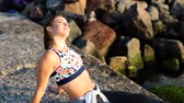 Woman working out on summer the beach Stock Footage