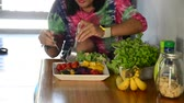 dressing : Woman cooking vegetable and fruit Salad. Stock Footage