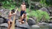 bolaven : Laos children used fishingnet catch fish in stream of Tad Yeang waterfall at Bolaven Plateau on May 2 2015 in Paksong Champasak Laos.