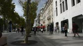 사치 : French people and foreigner travelers walking visit and shopping at sidewalk in L%u2019avenue des Champs-Elysees on September 6, 2017 in Paris, France 무비클립