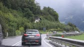 osztrák : Travelers people driving car on the highway road at countryside passed Oetztal tiroler village go to Meran or Merano city of on September 2, 2017 in Tyrol, Austria