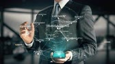 inventário : Businessman with Financial Planning hologram concept Stock Footage