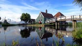 europa : Cheese factory building at Zaanse Schans reflected on the calm canal water, in Zaandam, Netherlands
