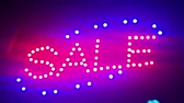 Illumination Sale. Street sign with small lights, garlands. Scenery with glowing, flashing lights. Dynamic, motion footage. Holiday movie. Stok Video
