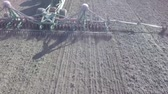grain growing : A tractor with a pneumatic seeder sows a field. Stock Footage