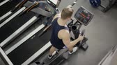 strength : Sportsman doing cardio exercise in gym