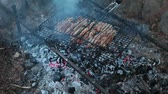 flank : The process of cooking meat on the grill over charcoal fire