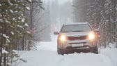 lifestyle : Stuck in the snow car is headlights turned on are on the forest winter road Stock Footage