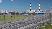 junção : City Ring Road ramp. Saint-Petersburg highway with driving vehicles. Summer season. Russia