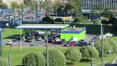 energy : Cars refueling at Neste petrol station in center of St Petersburg city, timelaple. Russia