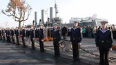 celebration : ST. PETERSBURG, RUSSIA - SEPT, 21, 2014: Cruiser Aurora mooring place with sailors stand in line when ship is ready to tugging for repair works. Cruiser Aurora is a symbol of Revolution of 1917 year