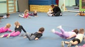 eğitim : Children doing exercises on the lesson in acrobatics for preschoolers in Russian sport school, Russia