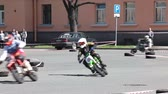 asphalt : Open Championship of St. Petersburg highway-ring racing on scooters and mini-moto pitbikes, Russia Stock Footage