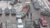 crashed : Defocused view of tow truck takeing broken car from the parking lot. Heavy snow. Saint-Petersburg, Russia Stock Footage