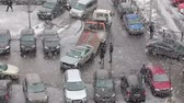 flatbed : View of tow truck loading broken car from the parking lot. Heavy snow. Saint-Patersburg, Russia Stock Footage