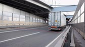 tourniquet : Vehicles stopping before fee booth in entrance of Western High-Speed Diameter tollway in Saint-Petersburg, Russia Stock Footage