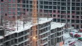 machinery : Urban construction site during winter holidays in Russia. Stopped cranes and machinery. Stock Footage