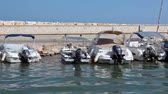 lancha : View from ship passing behind moored boats and yachts in bay of Latchi village, Cyprus