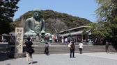 shu : The Great Buddha in the city of Kamakura in Kanagawa Prefecture, Japan. Seated Buddha Amida Nyorai, or Daibutsu Stock Footage